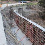 FOTO: Până la finele lunii august ar putea fi turnat un prim strat de asfalt pe tronsonul Colibița – Bistrița Bîrgăului – Prundu Bîrgăului